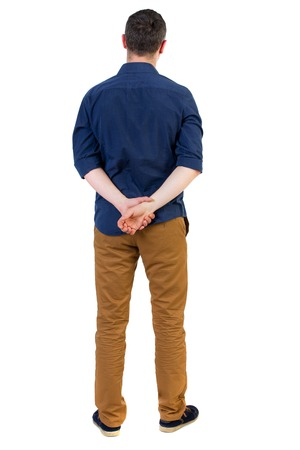 his shirt sleeves: Back view of man . Standing young guy. Rear view people collection.  backside view of person.  Isolated over white background. a man in a blue shirt with the sleeves rolled up, standing with his hands behind his back..
