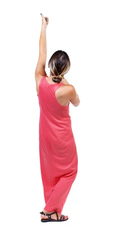 back view of standing girl pulling a rope from the top or cling to something. girl  watching. Rear view people collection.  backside view of person.  Isolated over white background. A slender woman in a long red dress shows thumb up raising his arm above