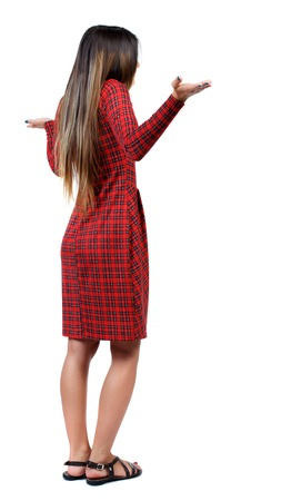 watching horror: Back view of angry young woman Rear view. isolated over white. backside view of person.  Rear view people collection. Isolated over white background. The girl in red plaid dress throws his hands in surprise.