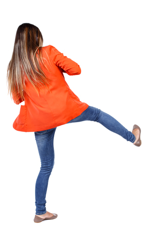 wimp: back view of woman funny fights waving his arms and legs. Rear view people collection. backside view of person.  Isolated over white background. student in a red jacket kicks.