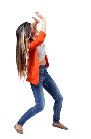 stumble: Balancing young woman.  or dodge falling woman. Rear view people collection.  backside view of person.  Isolated over white background. girl in red jacket close hands against the danger from above.