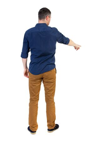 rolled up sleeves: Back view of pointing business man.  Rear view people collection.  backside view of person.  Isolated over white background. a man in a blue shirt with the sleeves rolled up showing in the bottom right hand. Stock Photo