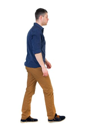 rolled up sleeves: Back view of going  handsome man. walking young guy . Rear view people collection.  backside view of person.  Isolated over white background. a man in a blue shirt with the sleeves rolled up is right. Stock Photo