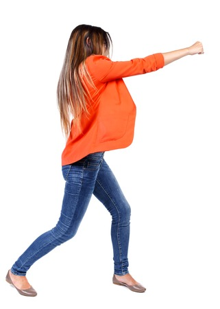 wimp: back view of woman funny fights waving his arms and legs. Rear view people collection. backside view of person.  Isolated over white background. business woman in a red jacket hand strikes.