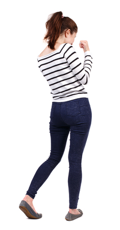 wimp: back view of woman funny fights waving his arms and legs. Rear view people collection. backside view of person.  Isolated over white background. Girl in a striped sweater boxing. Stock Photo