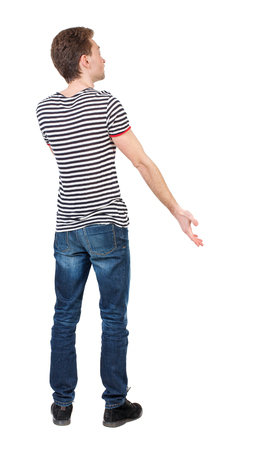 Back view of man . Standing young guy. Rear view people collection.  backside view of person.  Isolated over white background. Curly boy in a striped vest emotionally gesticulates.