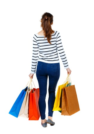 back view of going  woman  with shopping bags . beautiful girl in motion.  backside view of person.  Rear view people collection. Isolated over white background. Girl in a striped sweater went off shopping. Reklamní fotografie