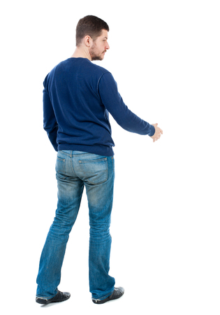 back view of businessman reaches out to shake hands. Rear view people collection. backside view of person. Isolated over white background. bearded man in blue pullover is preparing to shake hands.