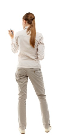 skinny girl: back view of writing beautiful woman. Rear view people collection.  backside view of person. Isolated over white background. Skinny girl in white denim suit writes a pen.