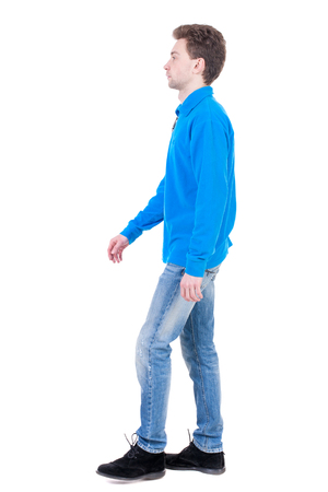 treading: Back view of going  handsome man. walking young guy . Rear view people collection.  backside view of person.  Isolated over white background. Curly boy in the blue jacket is thoughtfully to one side.