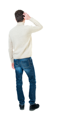Back view of man . Standing young guy. Rear view people collection.  backside view of person.  Isolated over white background. Curly short-haired guy in a white jacket wool scratching hand to head.