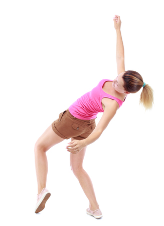 stumble: Balancing young woman.  or dodge falling woman. Rear view people collection.  backside view of person.  Isolated over white background. Sport blond in brown shorts at the time of the fall. Stock Photo