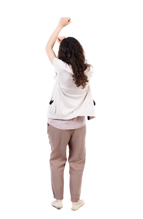 back view of dancing young beautiful  woman. girl  watching. Rear view people collection.  backside view of person.  Isolated over white background. Long-haired curly girl swings his arms above his head.