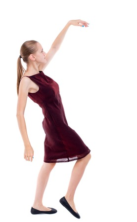 girl in burgundy dress: Balancing young woman.  or dodge falling woman. Rear view people collection.  backside view of person.  Isolated over white background. A girl in a burgundy dress leans back.