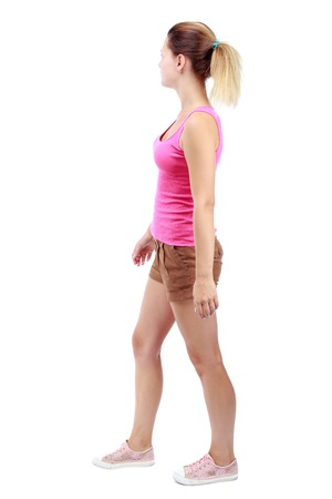 gir: back view of walking woman . going gir in motion. Rear view people collection.  backside view of person. Isolated over white background. Sport blond in brown shorts and misses looking to the side.