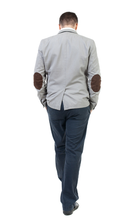 bowed head: Back view of walking businessman.  Rear view people collection. Backside view of person. Isolated over white background.  The bearded man in a gray coat walking with his hands in the pockets of his head bowed down. Stock Photo