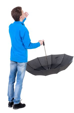 young man in in a white knit sweater under an umbrella. Rear view people collection.  backside view of person.  Isolated over white background. Curly boy in the blue jacket checks whether the rain ended.