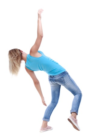 slipped: Balancing young woman.  or dodge falling woman. Rear view people collection.  backside view of person.  Isolated over white background. The blonde in a blue shirt and jeans slipped and falls on his back.