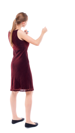 wimp: skinny woman funny fights waving his arms and legs. Isolated over white background. A girl in a burgundy dress sleeveless boxing.