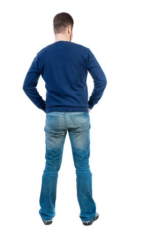 concentrated: back view of Business man  looks.  Rear view people collection.  backside view of person.  Isolated over white background. bearded man in blue pullover standing with his hands in his trouser pockets.