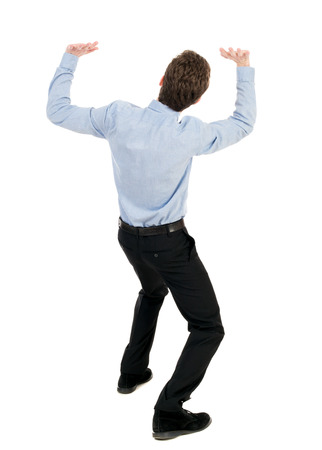 severity: back view of business man protects hands from what is falling from above. Man holding a heavy load. Rear view people collection.  backside view of person.  Isolated over white background. The curly-haired businessman in light shirt keeps the severity of t