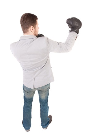 businessman with boxing gloves in fighting stance. Isolated over white background. Rear view people collection.  backside view of person. Top view of a businessman with boxing gloves.