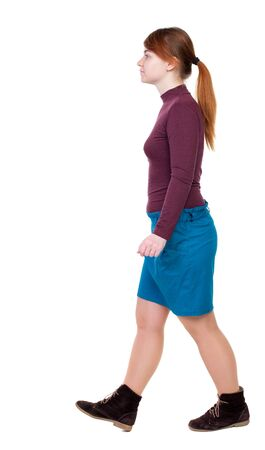 back view of walking  woman. beautiful blonde girl in motion.  backside view of person.  Rear view people collection. Isolated over white background. Girl with red hair tied in a pigtail goes to the side.