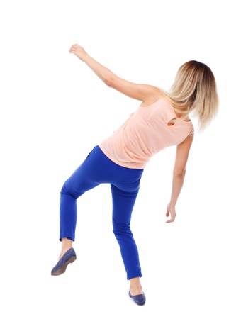 slipped: Balancing young woman.  or dodge falling woman. Rear view people collection.  backside view of person.  Isolated over white background. The blonde in a pink shirt and slipped down.