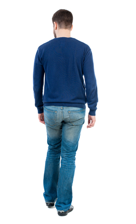 Back view of going  handsome man. walking young guy . Rear view people collection.  backside view of person.  Isolated over white background. bearded man in blue pullover is looking to the side.