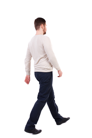 Back view of walking businessman.  Rear view people collection. Backside view of person. Isolated over white background. The bearded man in a white warm sweater is sitting diagonally.