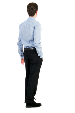 back view of Business man looks. Rear view people collection. backside view of person. Isolated over white background. Curly businessman in a light shirt looks into the distance.