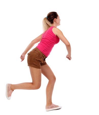 side view woman start position.  Rear view people collection.  backside view of person.  Isolated over white background. Sport blond in brown shorts running sprint. Stock Photo