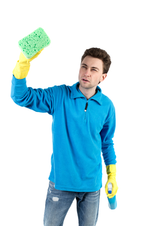 front view of a houseowner in gloves with sponge and detergent. man watching. Rear view people collection.  backside view of person.  Isolated over white background. The curly-haired man in a blue warm jacket engaged in cleaning