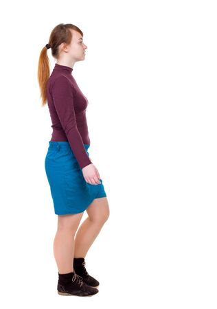 hair tied: back view of walking  woman. beautiful blonde girl in motion.  backside view of person.  Rear view people collection. Isolated over white background. Girl with red hair tied in a pigtail passes. Stock Photo