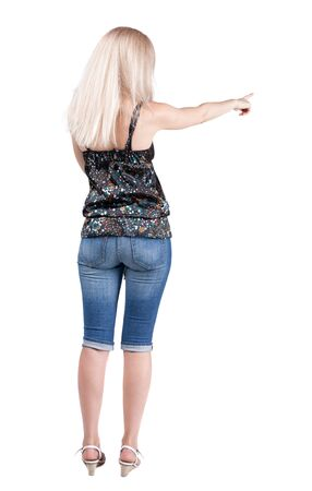 Back view of  pointing woman. beautiful blonde girl in jeans.  Rear view people collection.  backside view of person.  Isolated over white background.