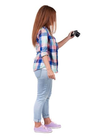 Back view of woman photographing. girl photographer in jeans. Rear view people collection.  backside view of person.  Isolated over white background. Stock Photo