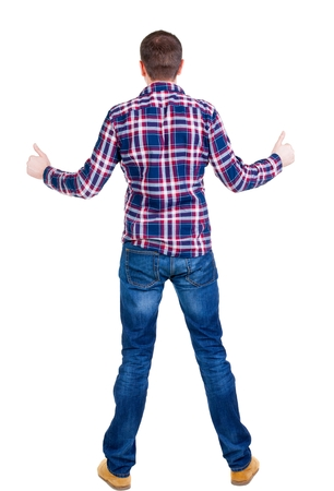 Back view of  man in checkered shirt shows thumbs up.   Rear view people collection.  backside view of person.  Isolated over white background. Stock Photo