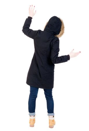 balances: Back view woman in winter jacket  Balances waving his arms.   Standing young girl in parka. Rear view people collection.  backside view of person.  Isolated over white background.