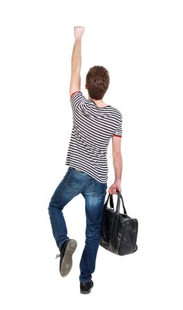 striped vest: Back view of man with bag. Curly boy in a striped vest with a bag depicts a superhero.