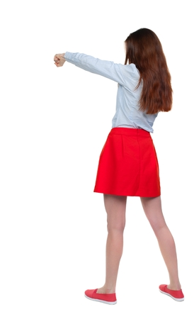 wimp: skinny woman funny fights waving his arms and legs. Long-haired brunette in red skirt boxing.