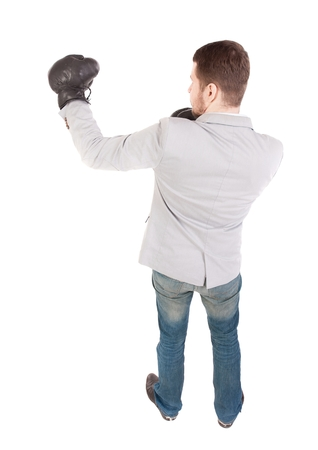 loser: businessman with boxing gloves in fighting stance. backside view of person. Top view of a businessman with boxing gloves.