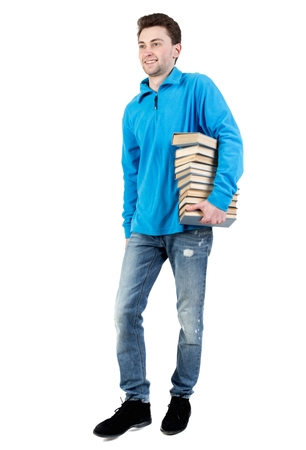book jacket: side view of going man carries a stack of books. curly-haired student in a blue warm jacket is smiling to meet us and carries the book.