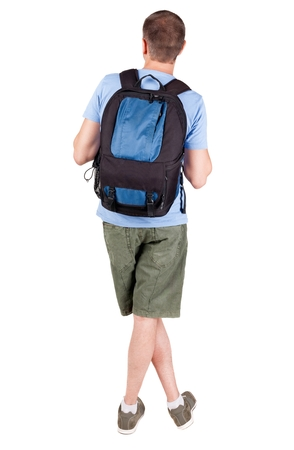 Back view of man with   backpack looking up. Rear view people collection.  backside view of person.  Isolated over white background. guy in the green t-shirt stands with a suitcase on wheels Stock Photo
