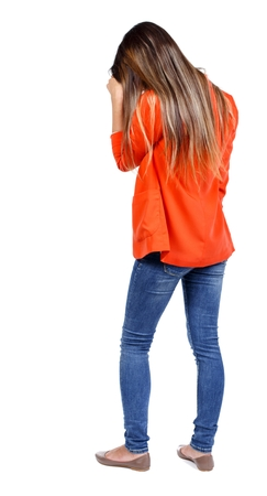 bowed head: back view of standing young beautiful woman. girl in a red jacket standing head bowed.