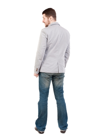 back view of Business man looks. guy in a gray jacket looking sideways.