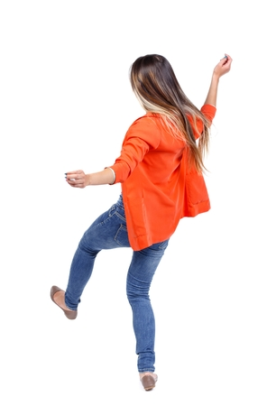 slipped: Balancing young woman. or dodge falling woman. girl in a red jacket slipped Stock Photo