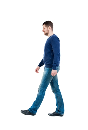 misses: Back view of going handsome man. walking young guy . bearded man in blue pullover thoughtfully misses.
