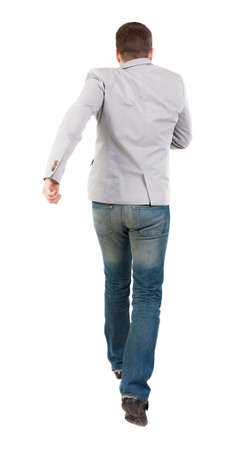 rushes: Back view of running business man. man in a gray jacket rushes into the distance. Stock Photo