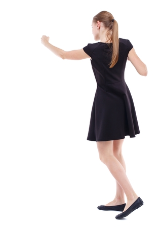 wimp: skinny woman funny fights waving his arms and legs. Blonde in a short black dress boxing