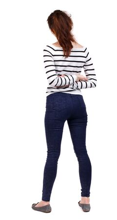 back view of standing young beautiful woman. girl watching. backside view of person. Stock Photo